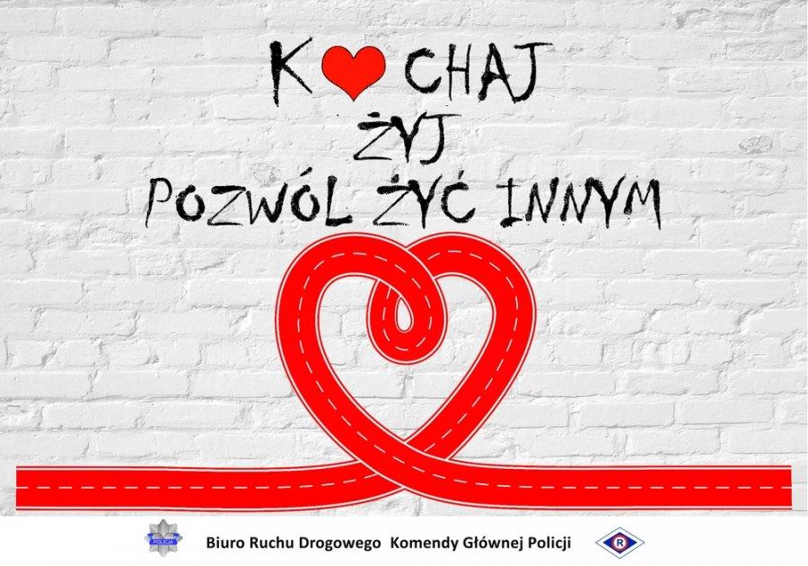 plakat z napisem kochaj żyj pozwól żyć innym w tle biała ściana z cebły i czerwone serce